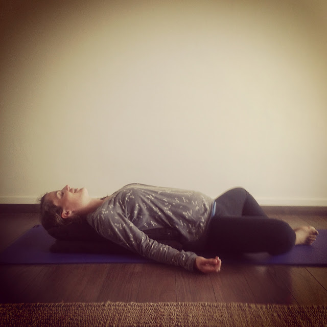 Lady relaxing on a yoga mat
