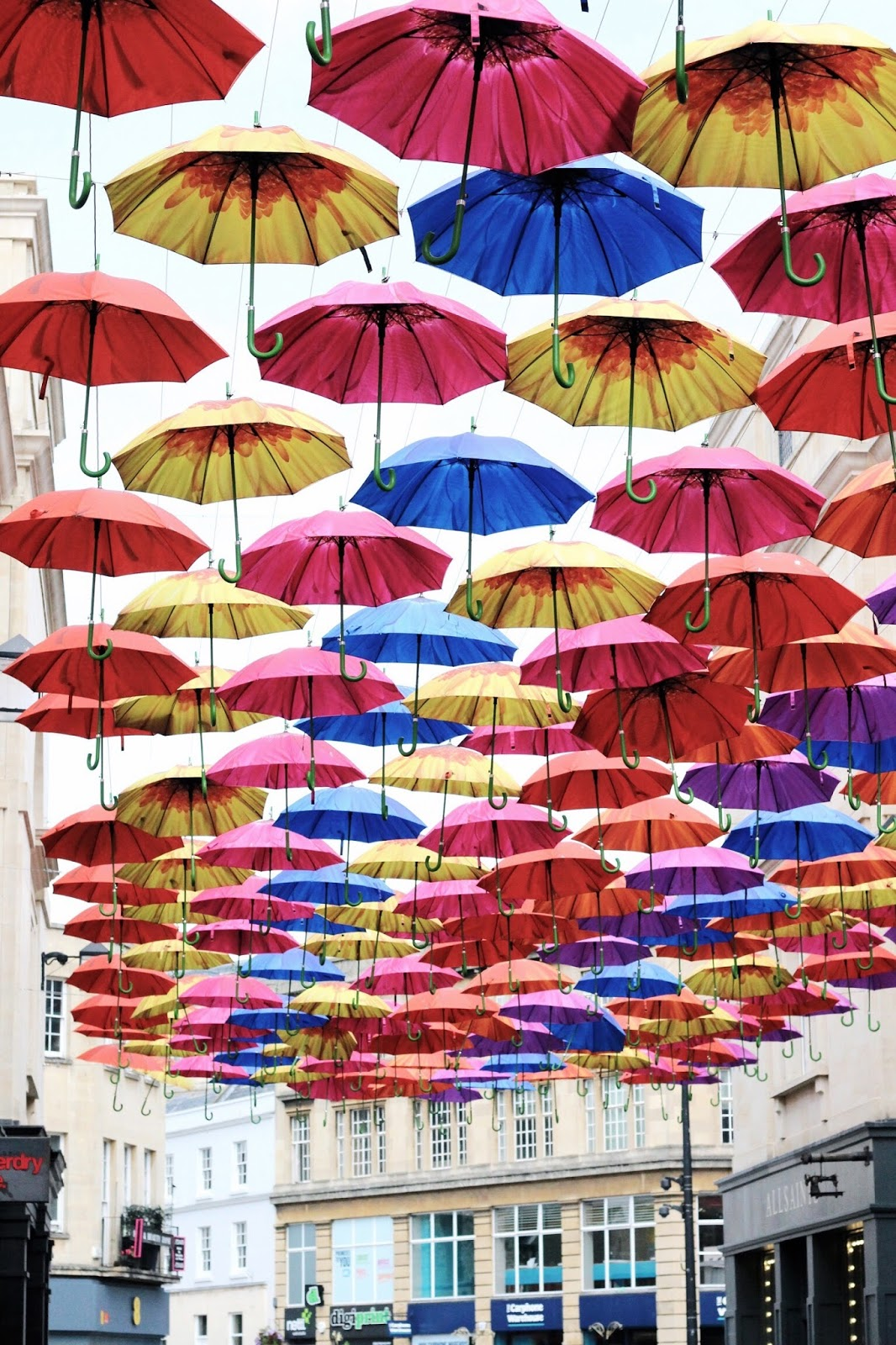 Bath colourful umbrella installation