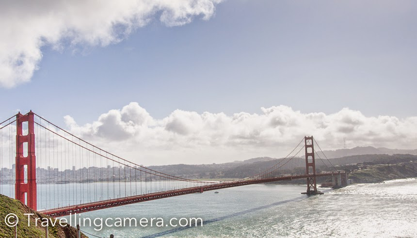 Golden Gate Bridge over which connects San Francisco with Pacific ocean is one of the main places to explore in San Francisco. I was there in 2013 and some of the office friends planned a full day Photo Walk around San Francisco. During this Photo-Walk we crossed this bridge many times and went around various places which offer some of the amazing views of the bridge. This Photo Journey shares some of the photographs clicked during this Photo-Walk.The Golden Gate Bridge is a suspension bridge links the U.S.  city of San Francisco, on the northern tip of the San Francisco Peninsula , to Marin County , bridging both U.S. Route 101  and California State Route 1  across the strait.Golden Gate Bridge is one the seven wonders of the modern world. This magnificent bridge, perhaps San Francisco's most famous landmark which was opened in 1937 after a four-year struggle against relentless winds, fog, rock and treacherous tides.Golden Gate bridge is one of the most internationally recognized symbols of San Francisco, California, and the United States. It has also been declared one of the Wonders of the Modern World  by the American Society of Civil Engineers.We drove to a neighboring hill and enjoyed some of the brilliant views of Golden Gate Bride, Pacific Ocean and an Francisco city. Battery Spencer, Marin County.One need to cross the bridge from the San Francisco side to the Marin County side to Battery Spencer, a former military installation that protected the bridge and the bay from foreign invaders during World War II. Head through the historic army artifacts and crumbling buildings to land's end where you'll be able to pose in your very own snapshot of the bridge with the breathtaking background of the entire city of San Francisco behind you.Another photograph of Golden Gate Bridge from Battery Spencer, Marin County..One of the largest urban parks in the world, Golden Gate Park stretches for three miles on the western edge of San Francisco. It's huge and approximately 1000+ acres, which sounds unbelievable.Golden Gate Bridge is 1.7 miles from San Francisco to the Marin headlands. The sidewalks on Golden Gate Bridge are open during the day to pedestrians including wheelchair users and bicyclists. When I was there, I saw huge groups of cyclists enjoying their ride on Golden Gate Bridge.Fort point is another god place to click Golden Gate Bridge.  This is a place which exposes you to brilliant architecture of Golden Gate Bridge. This is another former military installation which allows everyone to feel the mist from the bay waves crashing ashore while being directly underneath the bridge. Getting here from Fisherman's Wharf  and Pier 39 is  brisk walk and bike ride through the scenic Marina District and into the Presidio along the water's edge. There's parking here too, free of charge, but it can be in short supply during peak visiting hours.During the visit we went to the base of Golden Gate Bridge, where lot of surfers were enjoying the pacific waves.We spent some time around the shore and watched these surfers playing with water waves in chilling weather. We were carrying some snacks with us, so thought of having some around the ocean.If you are holding a camera I am sure that you would not want to get away from these beautiful locations which give different view/perspective of Golden Gate Bridge.This is a photograph of huge iron chains installed around the shoreline near Fort point. I clicked lot of photographs of these and would share a separate Photo Journey on that.In few weeks I will be there again and hope to bring back more beautiful memories for you all.