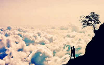 Couple-on-top-of-the-hill-touching-clouds-pics