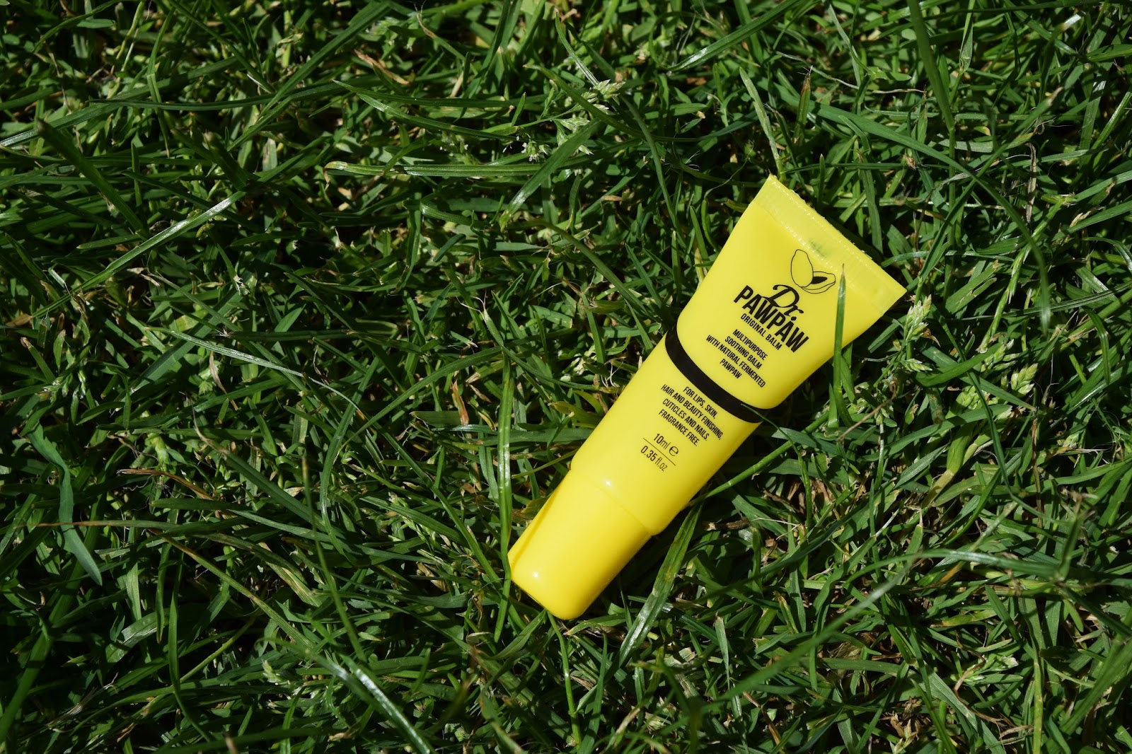a yellow sample tube of Dr PawPaw lipbalm