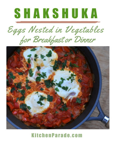 Shakshuka (Eggs Nested in Summer Vegetables) ♥ KitchenParade.com, a traditional North African and Israeli dish, just peppers and tomatoes slowly simmered, then 'nested' to cook whole eggs.