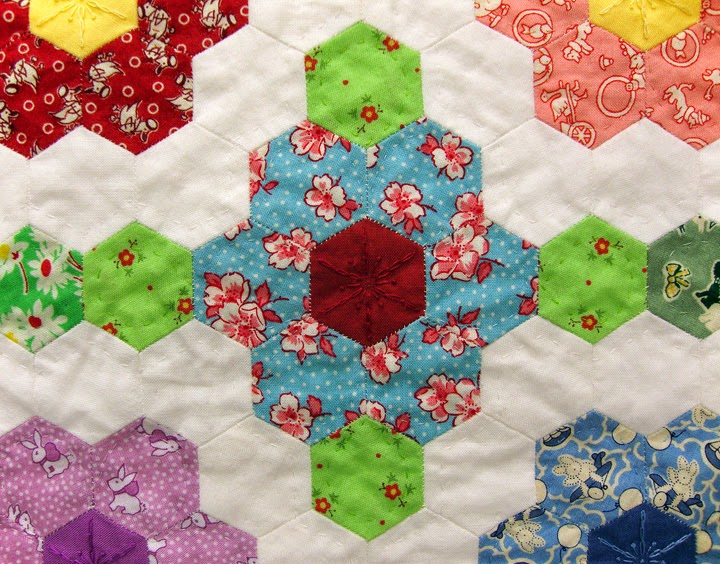 Grandmothers Flower Garden hexie quilt, Robin Atkins, quilted leaves