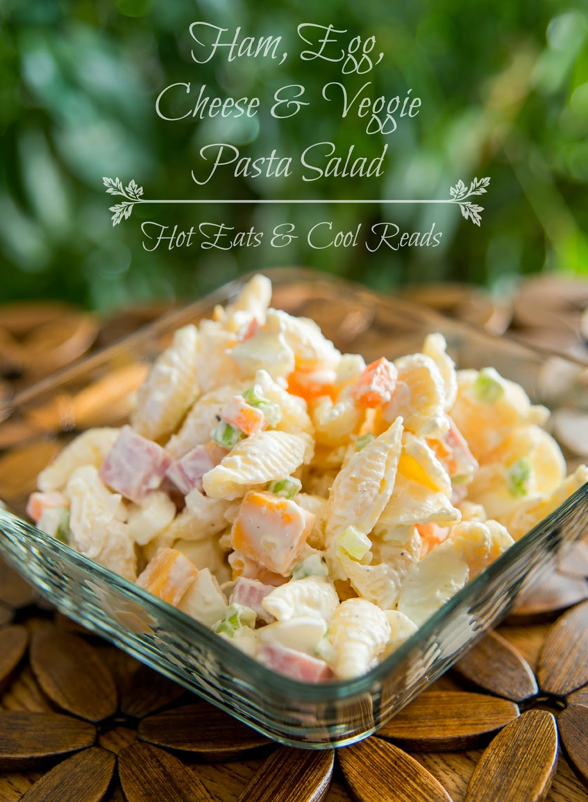Perfect for any picnic, BBQ, potluck or event! This salad feeds a crowd and it's everyone's favorite! Ham, Egg, Cheese and Veggie Pasta Salad Recipe from Hot Eats and Cool Reads