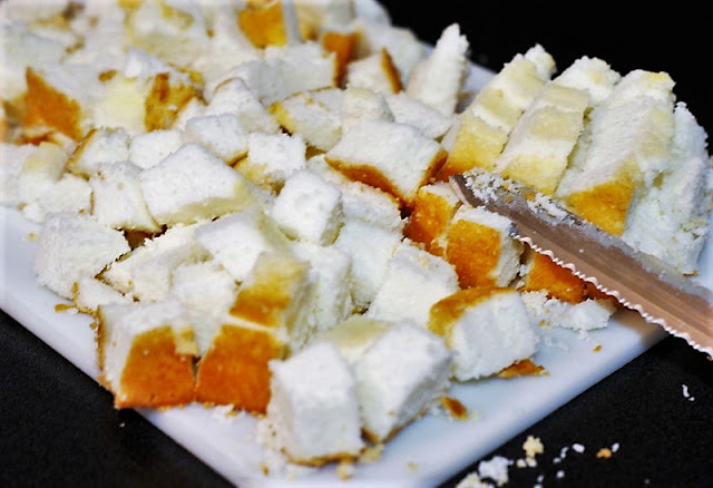 Cutting Angel Food Cake Cubes for Strawberry Punch Bowl Cake Image