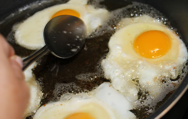 Fry eggs in bacon fat