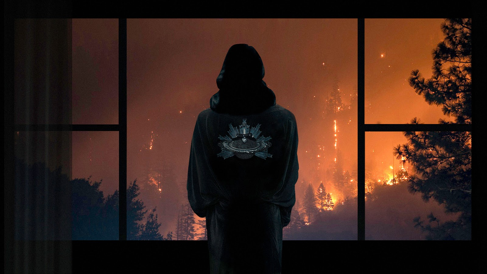 Iva Sokovic wearing her Saturn robe, drinking martini and overlooking a forest fire