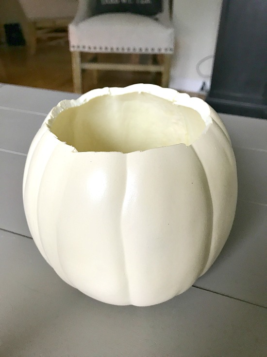 White faux pumpkin with top removed for centerpiece