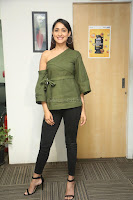 Pragya Jaiswal in a single Sleeves Off Shoulder Green Top Black Leggings promoting JJN Movie at Radio City 10.08.2017 078.JPG