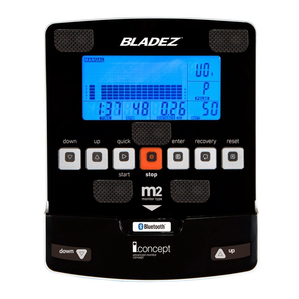 Bladez Fitness U500i console with blue backlit LCD display and iConcept technology, shows workout stats including time, speed, distance, calories burned and heart-rate