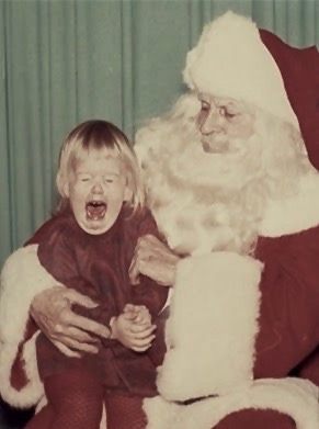 A very sad litttle girl cries on Santa's lap. c 1970s.A Pleasant Christmas Story and other stories of Christmas Creepers. marchmatron.com