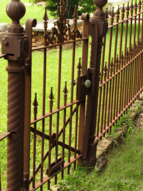 Wrought iron fence surrounding family cemetery plot
