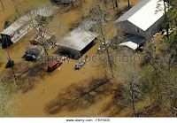Aerial view of homes submerged in floodwaters along the Pearl and Leaf Rivers after record breaking storms dumped rain across the deep south March 13, 2016 in St. Tammany Parish, Louisiana. (Credit: US Army Photo / Alamy Stock Photo) Click to Enlarge.