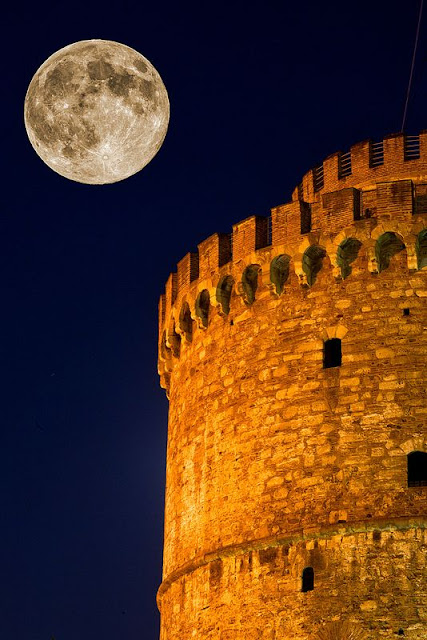 Full moon over The White Tower Thessaloniki Greece