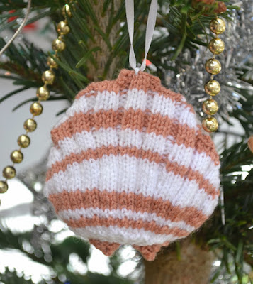 https://www.craftsy.com/knitting/patterns/scallop-shell/122944