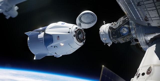 In this illustration, a SpaceX Crew Dragon spacecraft approaches the International Space Station for docking. Credit: NASA/SpaceX