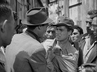 the flustered father gets involved in a brawl while searching for his cycle, bicycle thieves, directed by vittorio de sica
