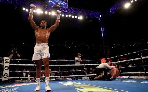 Povetkin goes down on the canvas as Anthony Joshua lands a killer blow.