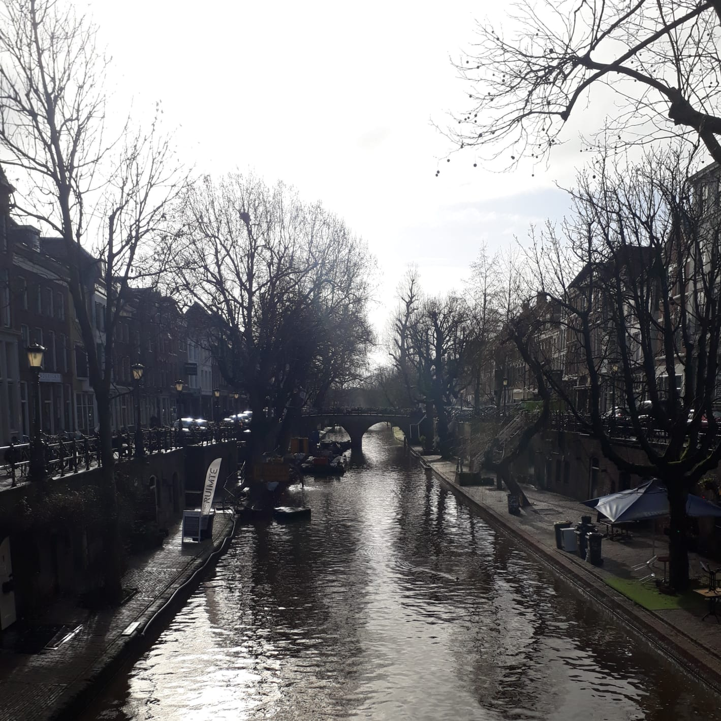 "This picture depicts the canals of Utrecht, 2019. The Oudegracht, or ""old canal"", runs through the center of Utrecht, the Netherlands. It starts in the southeast of the city. 
