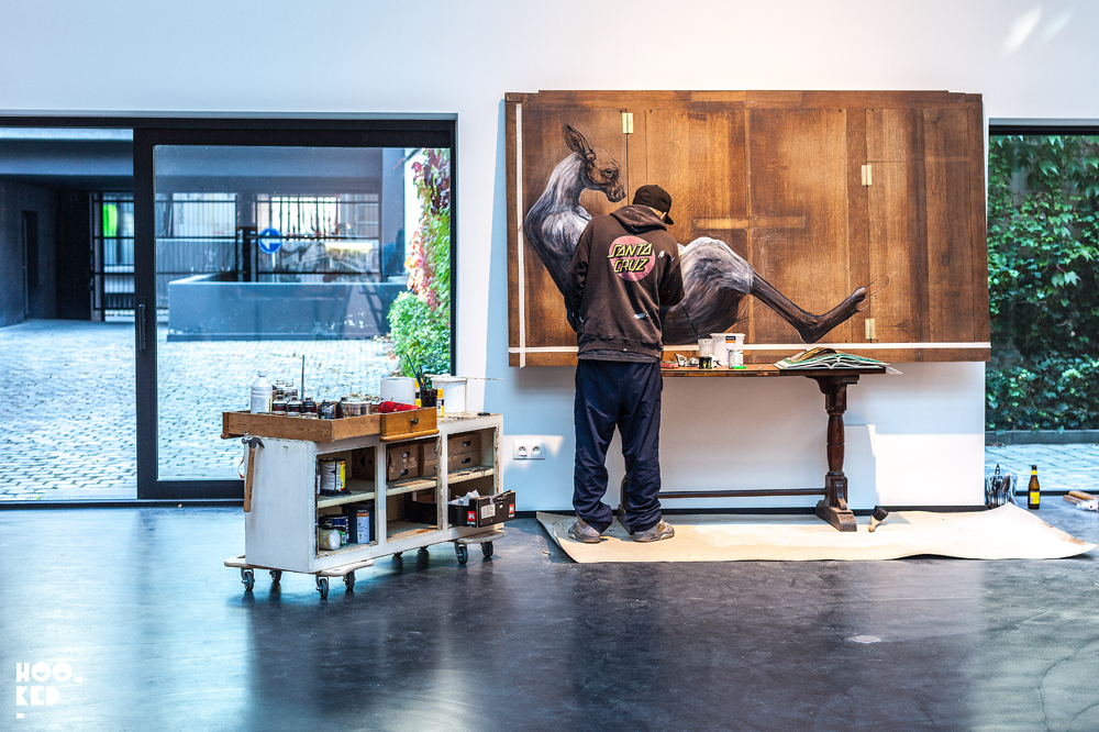 Belgian street artist ROA at work in his studio