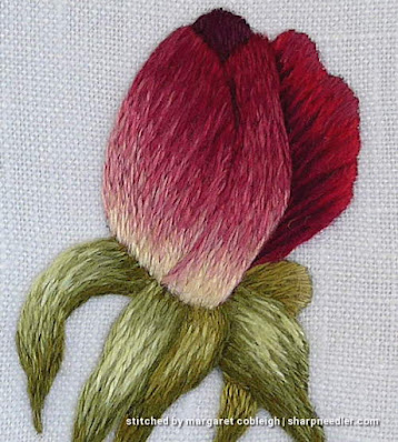 Closeup of thread painted rosebud (design by Trish Burr)