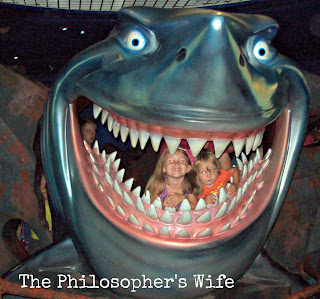 Two kids in Bruce's mouth, from Finding Nemo, located in the Seas at EPCOT.