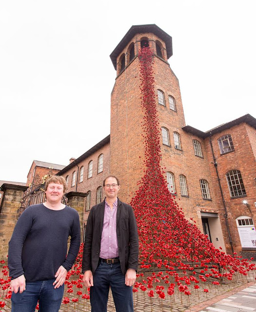 Over 800,000 ceramic flowers creep up building in England