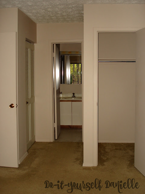 Photo looking into the master bathroom from the master bedroom. 1980's style condo.