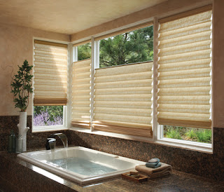 PowerView Motorization makes it easy to adjust these Hunter Douglas Vignette Modern Roman shades to different levels on a window grouping.