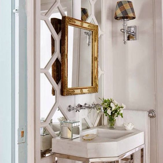 mirror on mirror in powder room