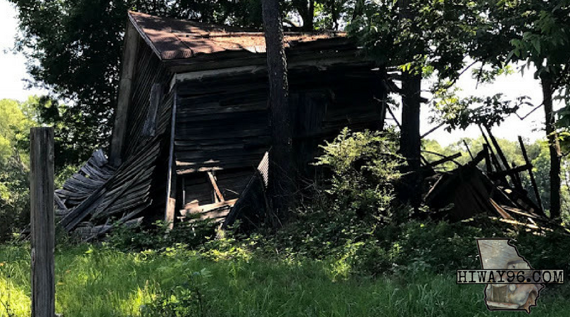 Worn by weather, this Rustic remains of a home is on Hiway 96, Georgia.