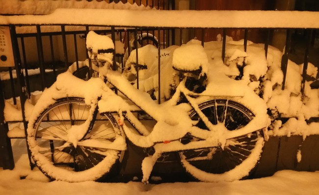 A bike nicely coated with snow...=)