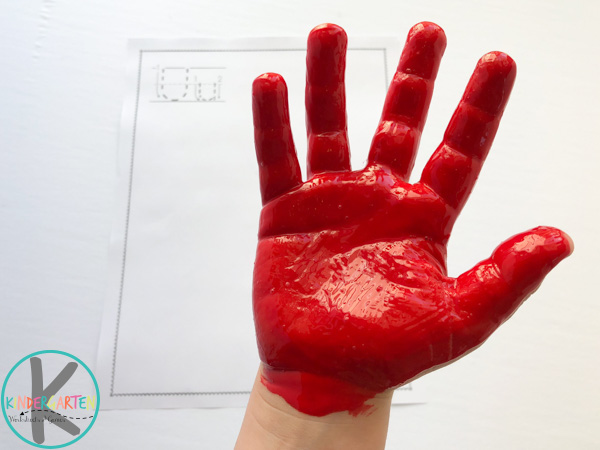 red paint on kids hand