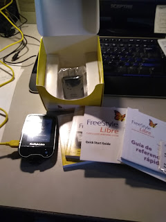 contents of reader box: reader, USB cord, USB charger, and both English and Spanish versions of the quick start guide, quick reference guide, and manual