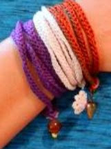 http://www.craftsy.com/pattern/crocheting/accessory/charmed-wrap-bracelet-free-pattern/21085