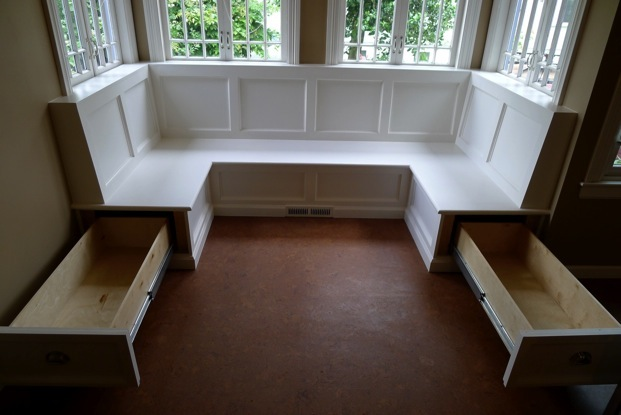 A custom made built in kitchen banquette with bench ...