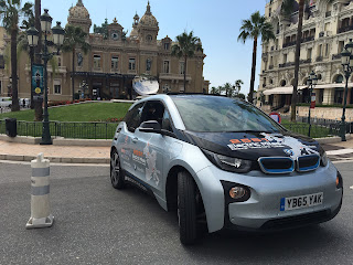 A BMW i3 electric car with range extender petrol engine parked in front of Monaco casino
