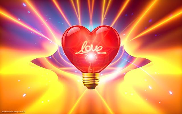 Rood liefdes hartje in de vorm van een gloeilamp met de tekst love