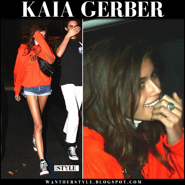 Kaia Gerber in orange sweatshirt shadow hill, denim shorts redone and black sneakers converse model street style october 26 2017