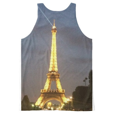 A printed tank top with a picture of the floodlit Eiffel Tower at night in Paris France.