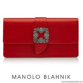 Meghan Markle carried Manolo Blahnik Capri Red Satin Jewel Buckle Clutch