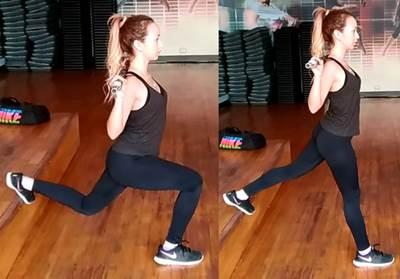 Zancada con barra sobre músculo trapecio y apoyo sobre superficie alta
