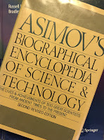 Asimov's Biographical Encyclopedia of Science and Technology, superimposed on the cover of Intermediate Physics for Medicine and Biology.