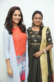 Actress Suma in Black Salwar Suit and Anusuya in orange Dress at winner movie press meet part 1 February 2017 (16).JPG