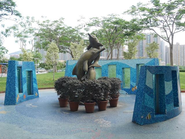 sculpture of dolphins in Tsuen Wan Park in Hong Kong