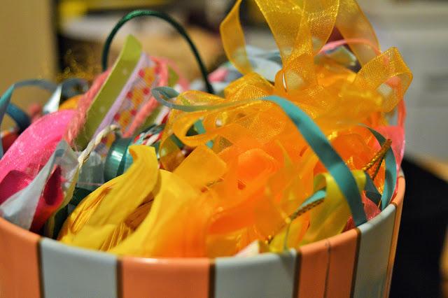 A tub full of ribbons.