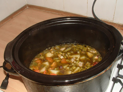 A slow cooker with mixed vegetable soup