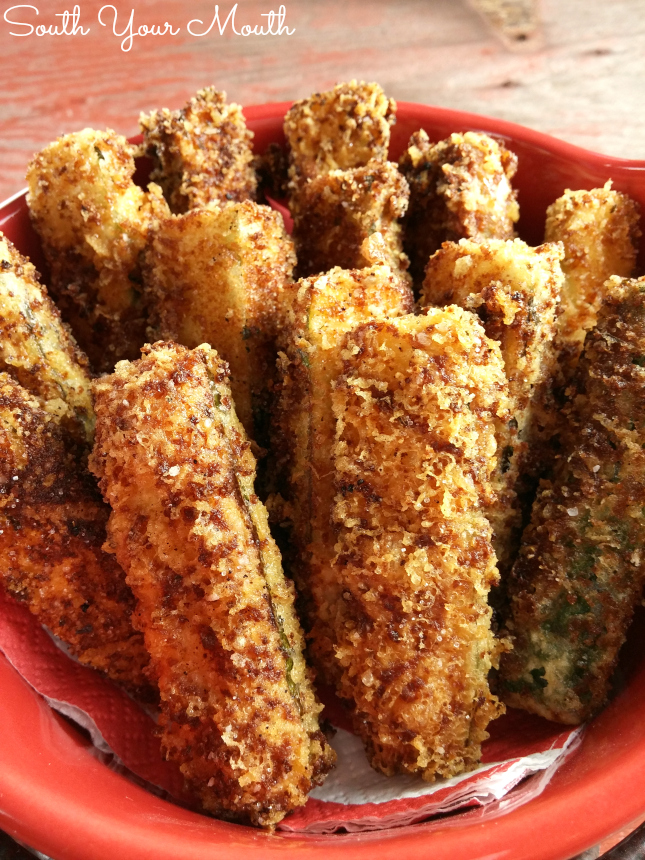 Delicious and easy fried zucchini! Dredged in grated asiago or parmesan and Italian bread crumbs then lightly fried in olive oil.