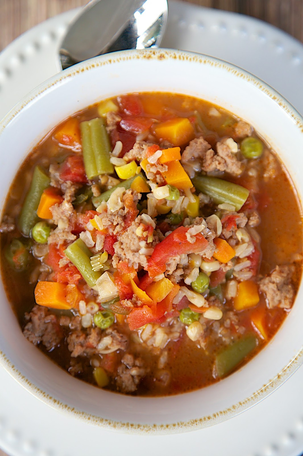 Turkey Vegetable Soup - ground turkey, mixed vegetables, beef broth and brown rice - ready in under 30 minutes. Leftovers are great for lunch and it freezes well. My husband gobbled this up! I've already made it 3 times this month!!