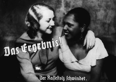 "Nazi propaganda photo depicts friendship between an ""Aryan"" and a black woman. The caption states: ""The result! A loss of racial pride."" Germany, prewar. — US Holocaust Memorial Museum"